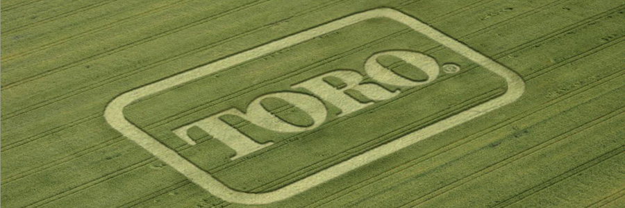 Bird's eye view of Toro logo mowed into the grass