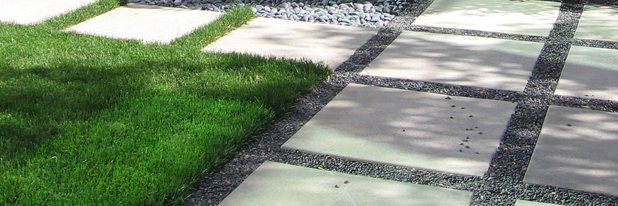 Lawn and aggregate walkway separated by Permaloc landscape edging